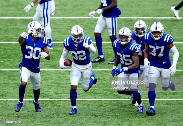 Julian Blackmon of the Indianapolis Colts celebrates his interception against the Cincinnati Bengals with his teammates during the second half at...