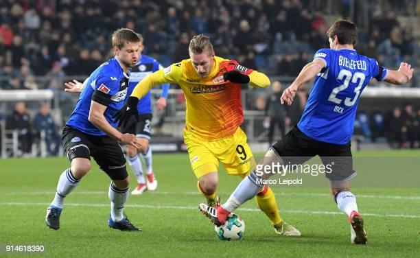 Julian Boerner of Arminia Bielefeld Sebastian Polter of 1FC Union Berlin and Florian Dick of Arminia Bielefeld during the Second Bundesliga match...