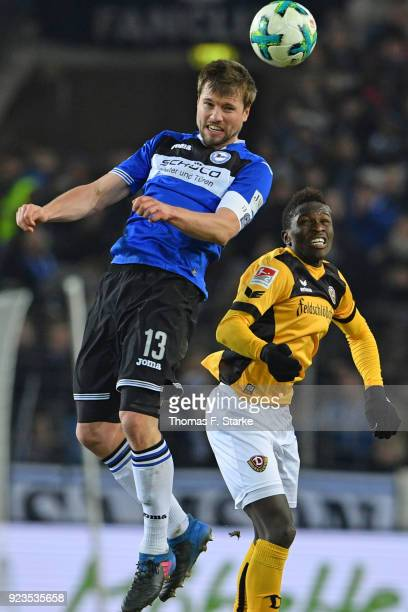 Julian Boerner of Bielefeld and Moussa Kone of Dresden head for the ball during the Second Bundesliga match between DSC Arminia Bielefeld and SG...