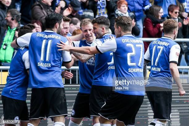 Julian Boerner of Bielefeld celebrates with his teammates after scoring a goal to make it 20 during the Second Bundesliga match between DSC Arminia...