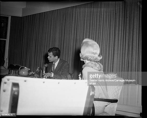 Julian Bond at press conference with reporter Eleanor Schano in foreground, University of Pittsburgh, Pittsburgh, Pennsylvania, February 1967.