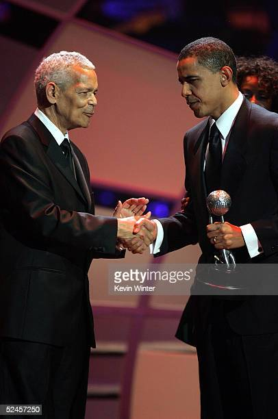 Julian Bond presents Senator Barack Obama with the Chairman's Award on stage at the 36th NAACP Image Awards at the Dorothy Chandler Pavilion on March...