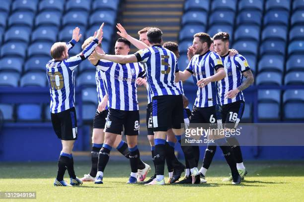 Julian Borner of Sheffield Wednesday celebrates with teammates after scoring their team's first goal during the Sky Bet Championship match between...