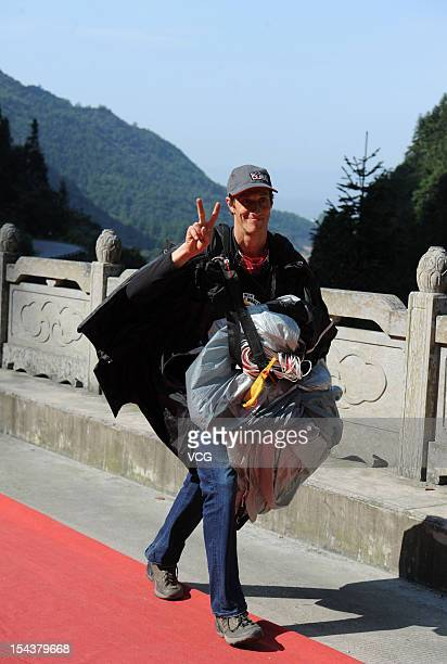 Julian Boulle of South Africa celebrates after winning the 2012 Wingsuit Flying World Championship at Tianmen Mountain on October 18 2012 in...
