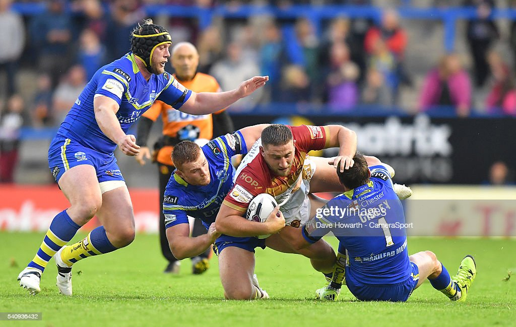 Julian Bousquet of Catalan Dragons is brought down during the First Utility Super League Round 19 match between Warrington Wolves and Catalans Dragons at the Halliwell Jones Stadium on June 17, 2016 in Warrington, United Kingdom.