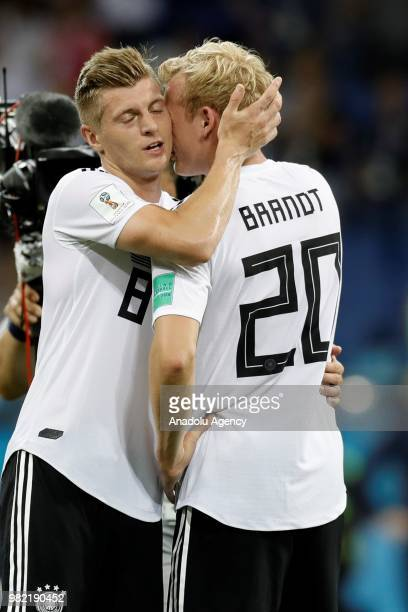 Julian Brandt and Toni Kroos of Germany celebrate after winning the match at the end of the 2018 FIFA World Cup Russia Group F match between Germany...