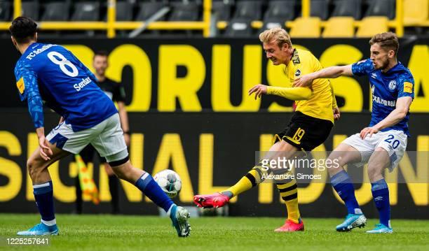 Julian Brandt (Cof Borussia Dortmund is challenged by Jonjoe Kenny of FC Schalke 04 during the Bundesliga match between Borussia Dortmund and FC...