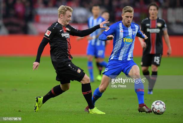 Julian Brandt of Bayer 04 Leverkusen and Arne Maier of Hertha BSC during the Bundesliga match between Bayer 04 Leverkusen and Hertha BSC at the...