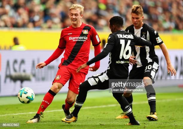 Julian Brandt of Bayer 04 Leverkusen battles for the ball with Ibrahima Traore and Nico Elvedi of Borussia Monchengladbach during the Bundesliga...