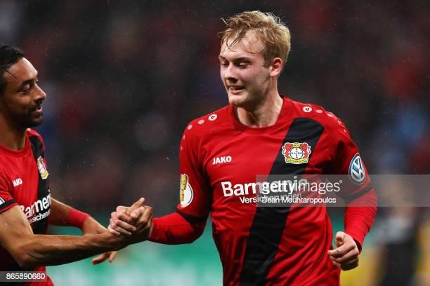 Julian Brandt of Bayer 04 Leverkusen celebrates scoring his teams first goal of the game with Karim Bellarabi during the DFB Cup match between Bayer...