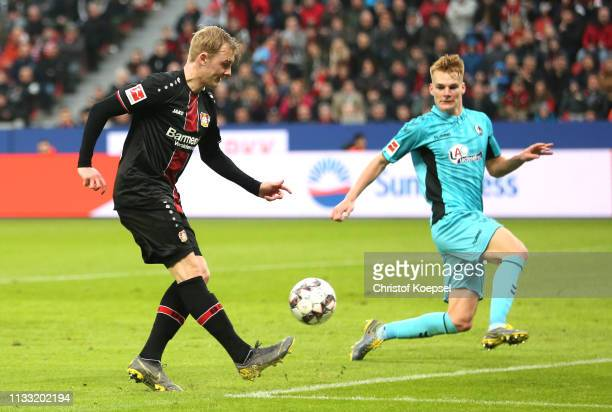 Julian Brandt of Bayer 04 Leverkusen provides the assist for their second goal during the Bundesliga match between Bayer 04 Leverkusen and SportClub...