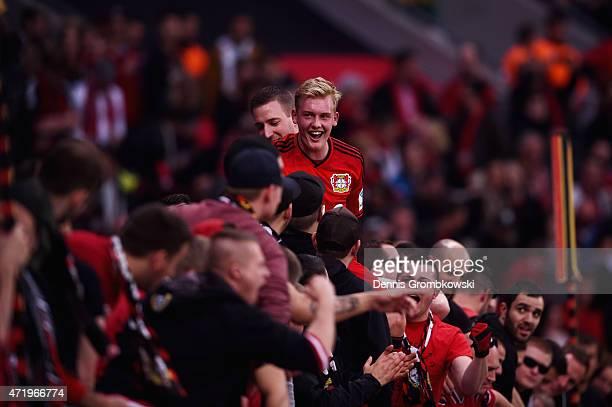 Julian Brandt of Bayer Levekusen celebrates with fans after the Bundesliga match between Bayer 04 Leverkusen and FC Bayern Muenchen at BayArena on...