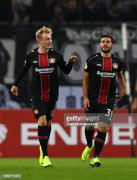Julian Brandt of Bayer Leverkusen celebrates scoring his side's first goal during the DFB Cup match between Borussia Moenchengladbach and Bayer 04...
