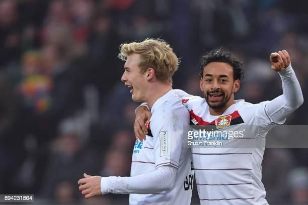 Julian Brandt of Bayer Leverkusen celebrates with Karim Bellarabi of Bayer Leverkusen after scoring his team's first goal to make it 01 during the...