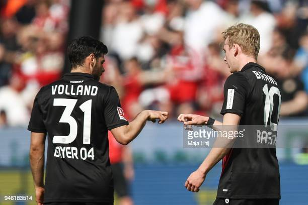Julian Brandt of Bayer Leverkusen celebrates with Kevin Volland of Bayer Leverkusen after scoring his teams first goal to make it 10 during the...