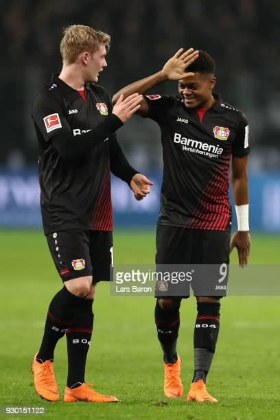 Julian Brandt of Bayer Leverkusen celebrates with Leon Bailey of Bayer Leverkusen after the Bundesliga match between Bayer 04 Leverkusen and Borussia...