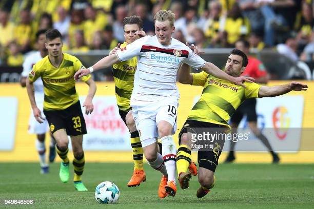 Julian Brandt of Bayer Leverkusen fights for the ball with Sokratis Papastathopoulos of Dortmund during the Bundesliga match between Borussia...