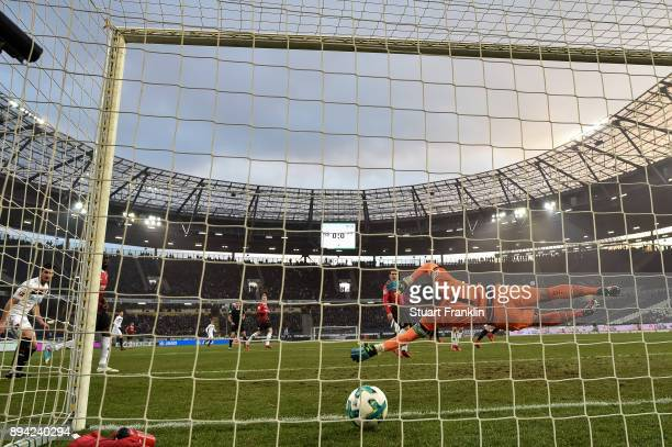 Julian Brandt of Bayer Leverkusen scores his team's first goal against Philipp Tschauner of Hannover 96 to make it 01 during the Bundesliga match...