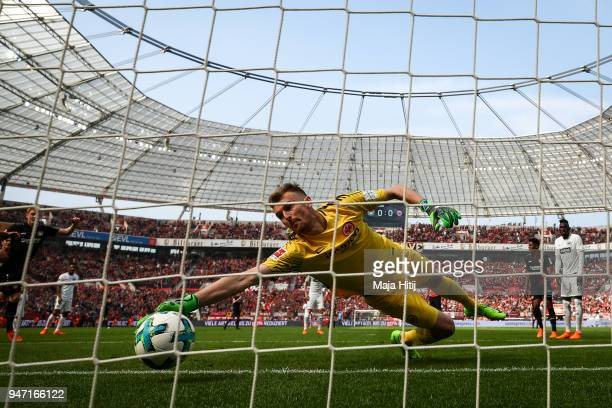 Julian Brandt of Bayer Leverkusen scores his teams first goal past goalkeeper Lukas Hradecky of Eintracht Frankfurt during the Bundesliga match...