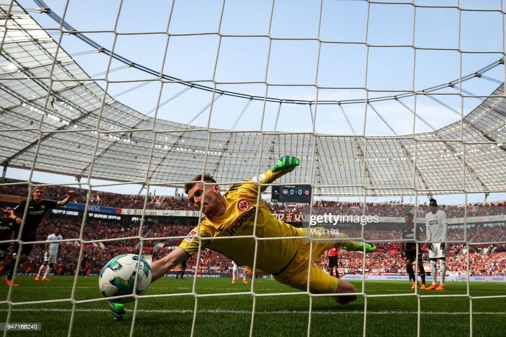 Julian Brandt #10 of Bayer Leverkusen scores his teams first goal past goalkeeper Lukas Hradecky #1 of Eintracht Frankfurt during the Bundesliga match between Bayer 04 Leverkusen and Eintracht Frankfurt at BayArena on April 14, 2018 in Leverkusen, Germany.