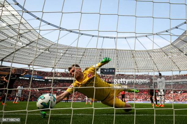 Julian Brandt of Bayer Leverkusen scores his teams first goal past goalkeeper Lukas Hradecky of Eintracht Frankfurt during the Bundesliga match...