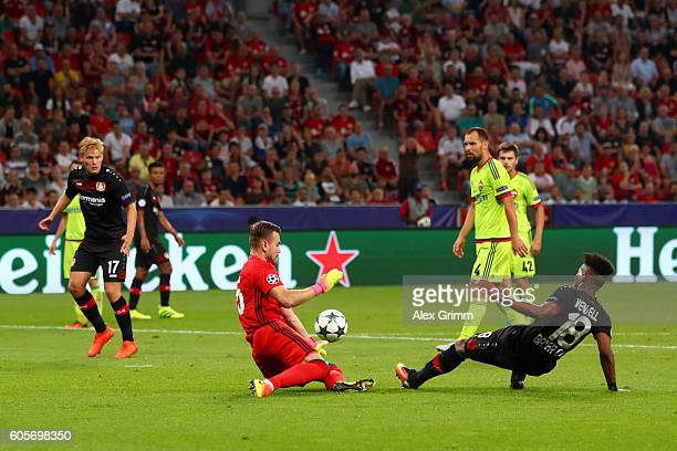 Julian Brandt of Bayer Leverkusen shoots at Igor Akinfeev of CSKA Moscow during the UEFA Champions League match between Bayer 04 Leverkusen and PFC...