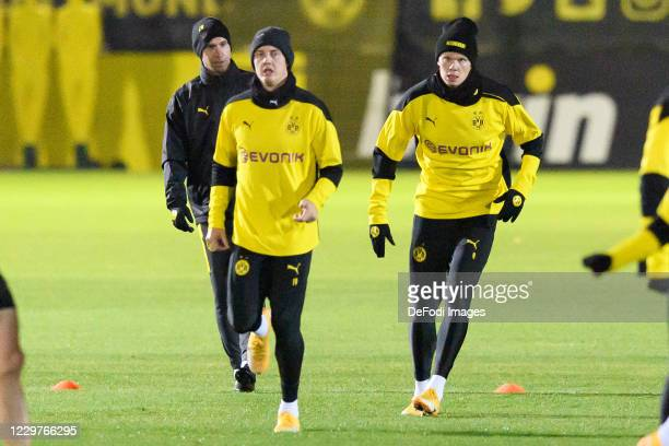 Julian Brandt of Borussia Dortmund and Erling Haaland of Borussia Dortmund look on ahead of the UEFA Champions League Group F stage match between...