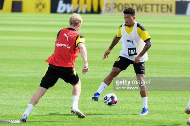 Julian Brandt of Borussia Dortmund and Jadon Sancho of Borussia Dortmund battle for the ball during the first training session after the summer break...