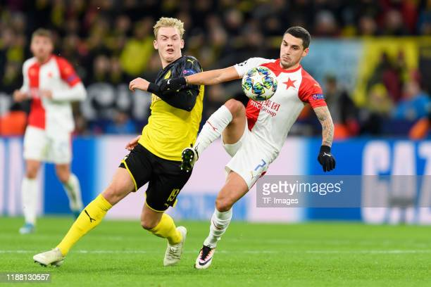 Julian Brandt of Borussia Dortmund and Nicolae Stanciu of Slavia Praha battle for the ball during the UEFA Champions League group F match between...
