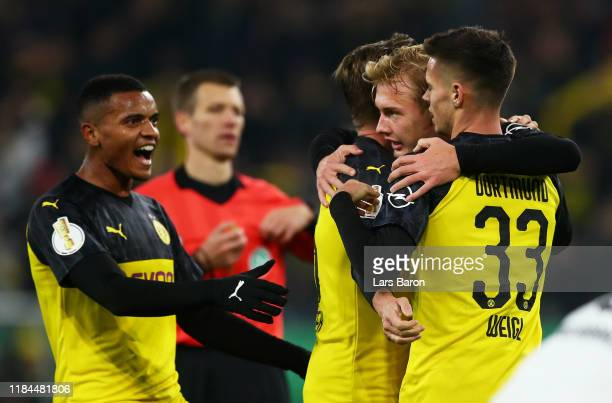 Julian Brandt of Borussia Dortmund celebrates after scoring his team's first goal with Mario Gotze and Julian Weigl during the DFB Cup second round...