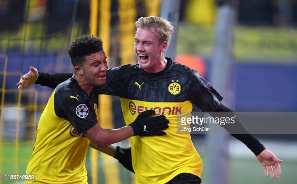 Julian Brandt of Borussia Dortmund celebrates after scoring his team's second goal with teammate Jadon Sancho during the UEFA Champions League group...