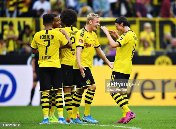 Julian Brandt of Borussia Dortmund celebrates scoring his sides fifth goal during the Bundesliga match between Borussia Dortmund and FC Augsburg at...