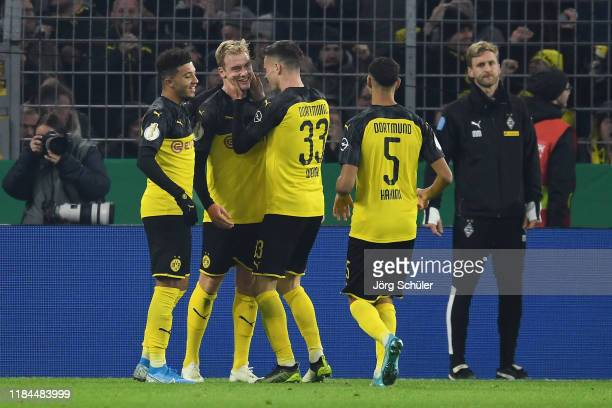 Julian Brandt of Borussia Dortmund celebrates with Jadon Sancho, Julian Weigl and Achraf Hakimi after scoring his team's second goal during the DFB...