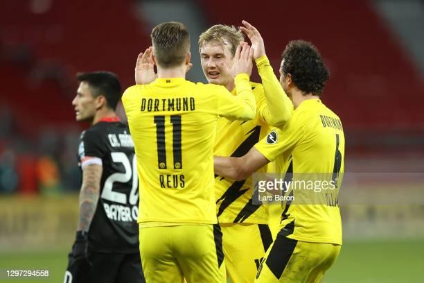 Julian Brandt of Borussia Dortmund celebrates with team mate Marco Reus of Borussia Dortmund after scoring their side's first goal during the...