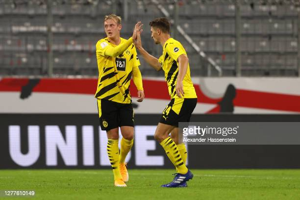 Julian Brandt of Borussia Dortmund celebrates with Thomas Meunier after scoring his team's first goal during the Supercup 2020 match between FC...