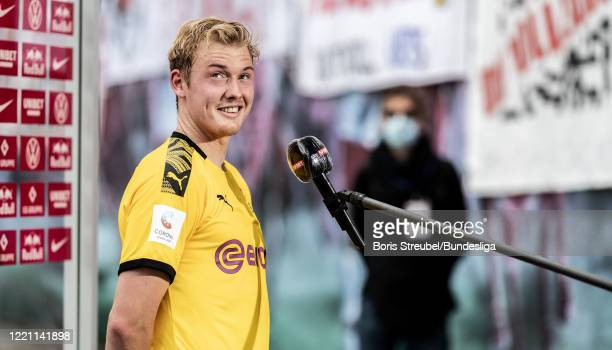 Julian Brandt of Borussia Dortmund gives an interview after the Bundesliga match between RB Leipzig and Borussia Dortmund at Red Bull Arena on June...
