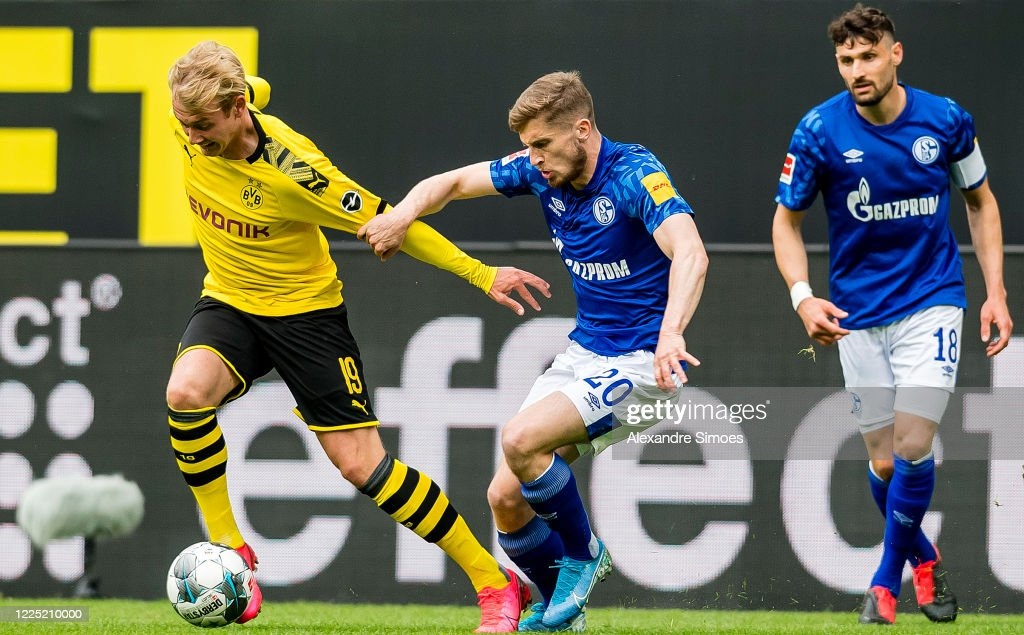 julian-brandt-of-borussia-dortmund-is-challenged-by-jonjoe-kenny-of-picture-id1225210000