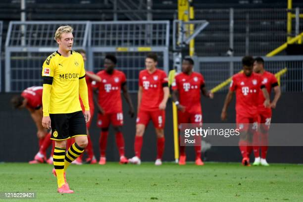 Julian Brandt of Borussia Dortmund reacts to Bayern Munich scoring there first goal during the Bundesliga match between Borussia Dortmund and FC...