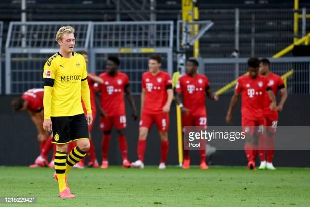 Julian Brandt of Borussia Dortmund reacts to Bayern Munich scoring there first goal during the Bundesliga match between Borussia Dortmund and FC...