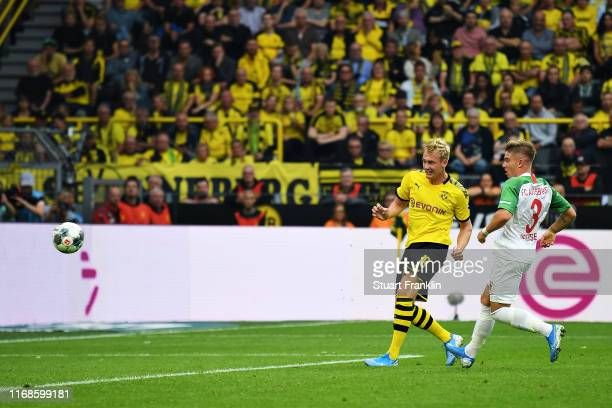 Julian Brandt of Borussia Dortmund scores his sides fifth goal during the Bundesliga match between Borussia Dortmund and FC Augsburg at Signal Iduna...