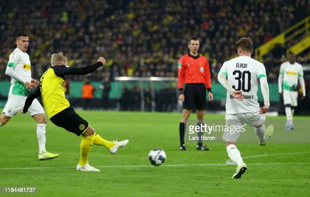 Julian Brandt of Borussia Dortmund scores his team's first goal during the DFB Cup second round match between Borussia Dortmund and Borussia...