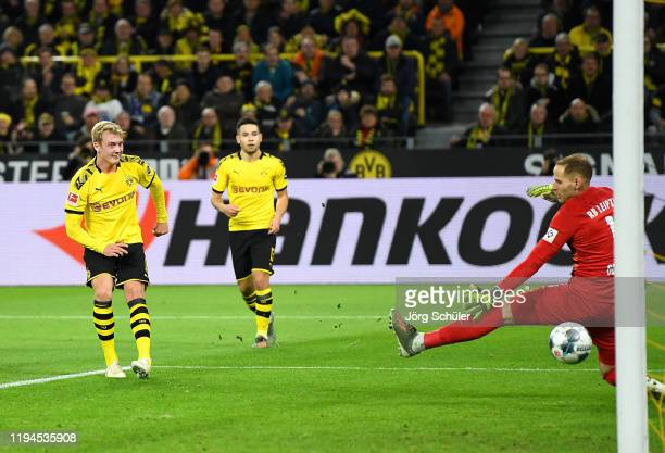 Julian Brandt of Borussia Dortmund scores his team's second goal past Peter Gulacsi of RB Leipzig during the Bundesliga match between Borussia...