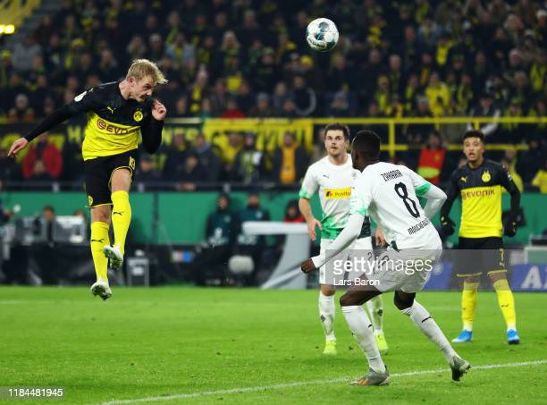 Julian Brandt of Borussia Dortmund scores his team's second goal during the DFB Cup second round match between Borussia Dortmund and Borussia...