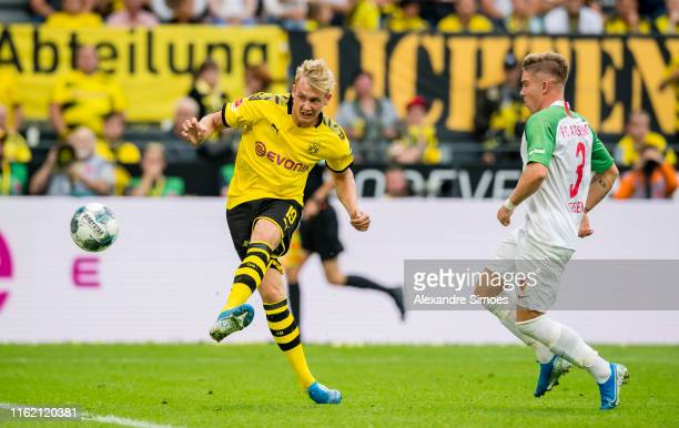 Julian Brandt of Borussia Dortmund scores the goal to the 51 during the Bundesliga match between Borussia Dortmund and FC Augsburg at the Signal...