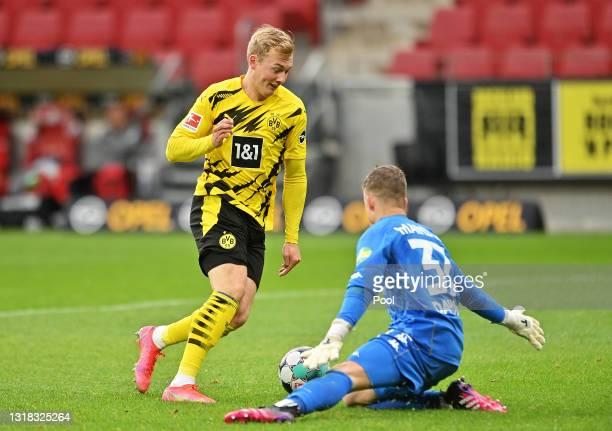 Julian Brandt of Borussia Dortmund taking the ball round Finn Dahmen of 1.FSV Mainz 05 before scoring his teams third goal during the Bundesliga...