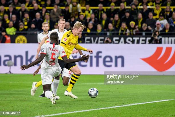 Julian Brandt of Dortmund against L-R Dayot Upamecano and Nordi Mukiele of Leipzig prior his goal for the 2-0 lead during the Bundesliga match...