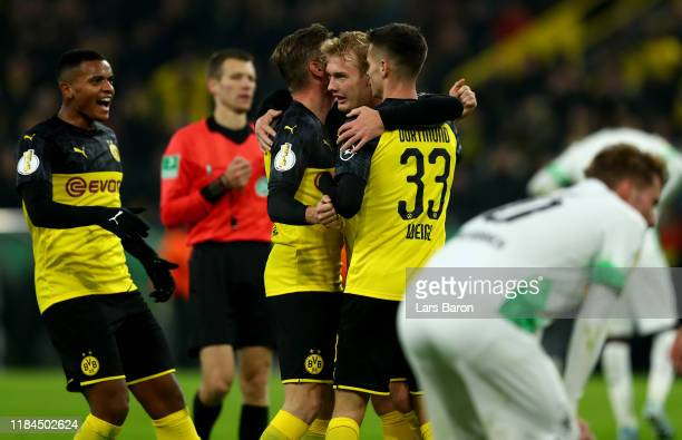 Julian Brandt of Dortmund celebrates with team mates after scoring his teams first goal during the DFB Cup second round match between Borussia...