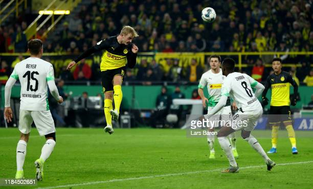 Julian Brandt of Dortmund heads his teams winning goal during the DFB Cup second round match between Borussia Dortmund and Borussia Moenchengladbach...