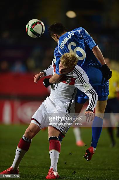 Julian Brandt of Gemany battles with Akramjon Komilov of Uzberkistan during the FIFA U20 World Cup New Zealand 2015 Group F match between Germany and...
