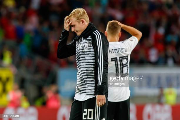 Julian Brandt of Geramny and Joshua Kimmich of Geramny after the international friendly match between Austria and Germany at Woerthersee Stadion on...